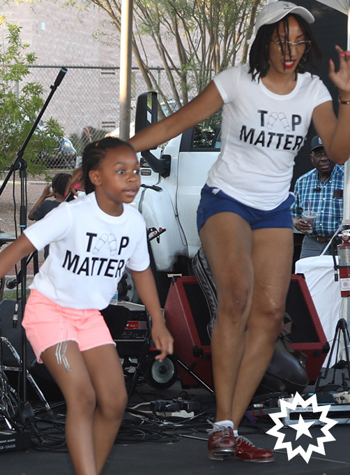 victoria jones founder of tap matters dances with students on stage at las vegas juneteenth festival 2019