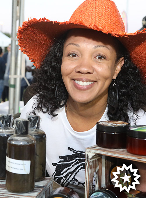 female vendor smiles with products at las vegas juneteenth festival 2019